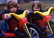 Littel Kids (Brothers) on their Big Wheels