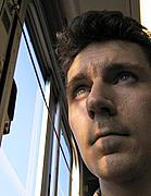 Man on the City Bus Looking out the Window