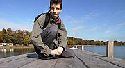 Man with Backpack on the Dock at Lake Harriet