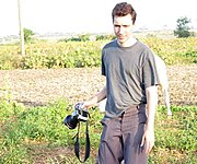 Photographer on Rural Farm in Asia
