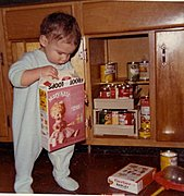 Marc as a Toddler Exploring Kitchen Cabinets