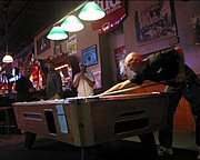 Man Playing Pool in a Bar