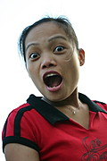 Young Filipina Woman with a Surprised Expression