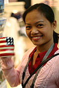 Woman Smiling with an American Flag Coffee Cup at a gift shop in Washington D.C.