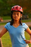 Young Woman with Bike Helmet Outdoors