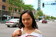 Young Woman at Uptown Intersection