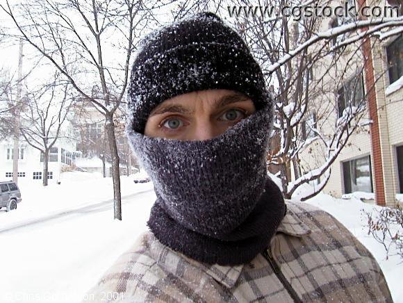 Close-Up of Man in Hat, Scarf After a Snowstorm