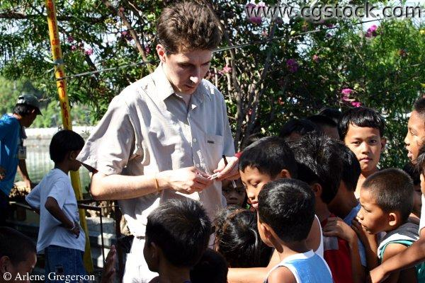 American Speaking Tagalog with Children in Manila