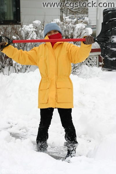 Victorious Woman Shovelling Snow