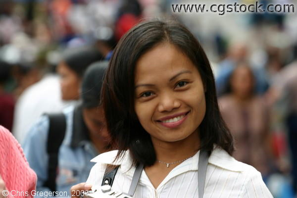A Smiling Lady in the Middle of the Crowd in Baguio Public Market, Baguio City, Philippines