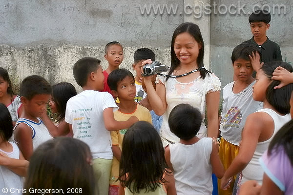 Arlene Surrounded by Children in Diamond Subdivision