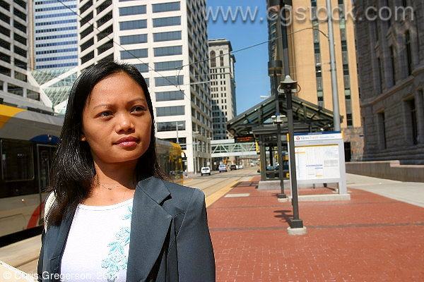 Asian Office Worker at the Government Plaza Light Rail Station