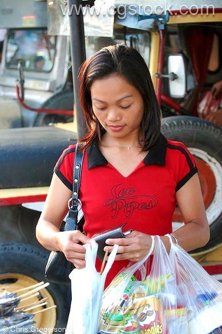 Filipina Buying Street Food, Philippines