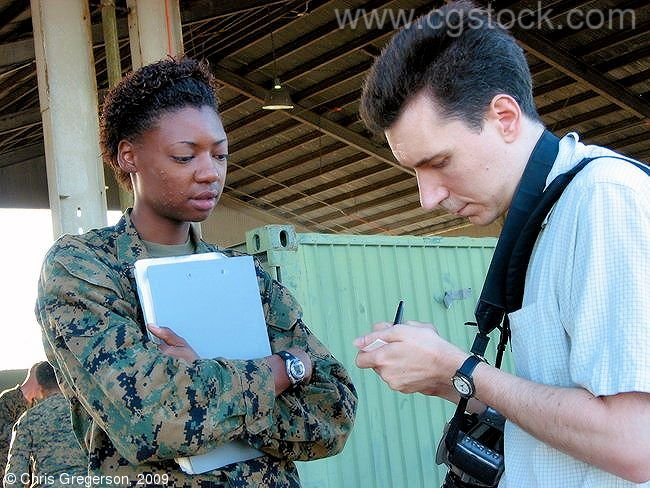 Photographer Taking Notes from Marine Public Information Officer, Philippines